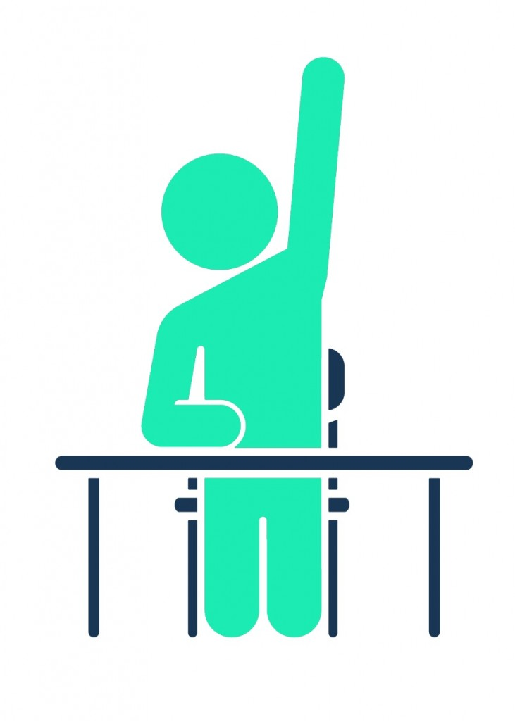 Man sitting at desk with his hand up